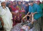 24-05-2002-Relatives mourn near dead body of a youth from Ba