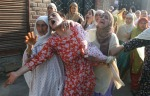 Pic-3 Relatives of Javed Ahmed Malla wail during his funeral